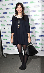 Daisy Lowe  arriving at Macmillan De'Longhi Art auction in London,  Monday, 23rd September 2013. Picture by Stephen Lock / i-Images