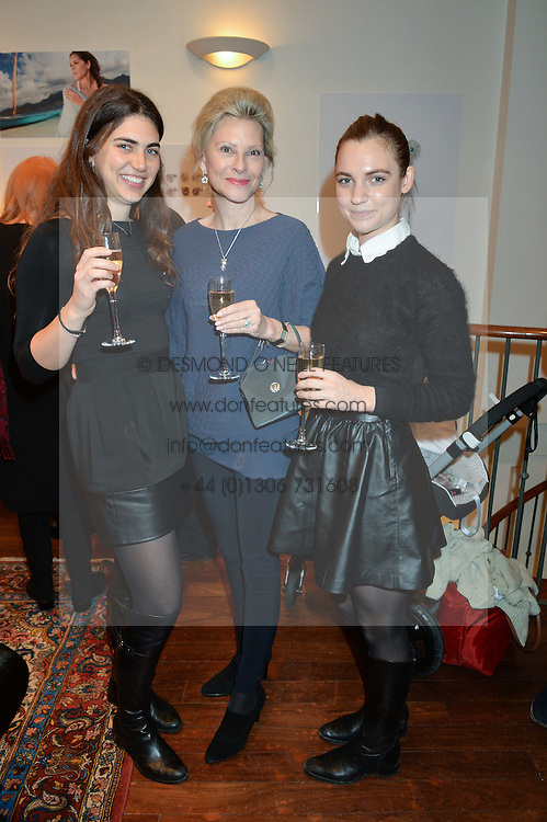 Left to right, JADE BARKETT, ANNIE GRAHAM and STEPHANIE LEDERLE at a pre christmas party & shopping evening at Patrick Mavros, 104-106 Fulham Road, London on 26th November 2014.