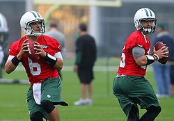 May 24, 2012; Florham Park, NJ, USA; New York Jets quarterback Tim Tebow (15) and New York Jets quarterback Mark Sanchez (6) stretch during the New York Jets OTA at their training facility.