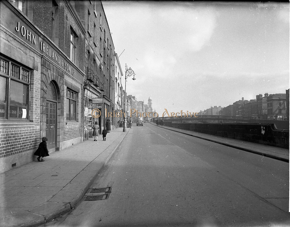 30/11/1952<br /> 11/30/1952<br /> 30 November 1952<br /> Dublin street scene. View on Ellis Quay towards Liam Mellows Bridge.  Image for Maurice L. Clifford Solicitors for accident case.