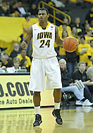 December 04 2010: Iowa Hawkeyes guard Bryce Cartwright (24) with the ball during the second half of their NCAA basketball game at Carver-Hawkeye Arena in Iowa City, Iowa on December 4, 2010. Iowa won 70-53.