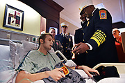 Birmingham Fire & Rescue stopped by hospital room of Warrior firefighter Bobby Reno to make him an honorary member of the service.  Reno, who is battling rhabdomyosarcoma, has always wanted to become a Birmingham firefighter.  (Tamika Moore / tmoore@al.com)