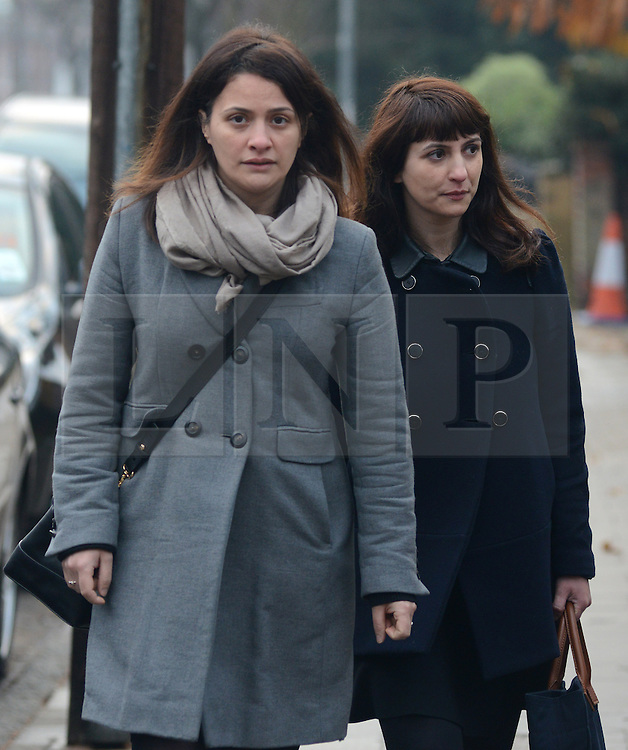 © Licensed to London News Pictures.10/12/2013. London, UK. Italian Sisters Elisabetta 'Lisa' (L) and Francesca ( in dark jacket) Grillo, who are the former personal assistants to Charles Saatchi and Nigella Lawson, arriving at Isleworth Crown Court in London. The pair, who face fraud charges, are accused of misappropriating funds while working for Saatchi and Lawson.Photo credit : Peter Kollanyi/LNP
