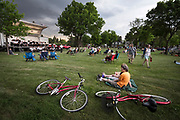 As the sky darkened and the wind picked up, guests began to leave while the Robbinsdale City Band played as long as possible before storms hit at Victory Memorial Flagpole Thursday May 24, 2018. (Courtney Perry for ClassicalMPR)