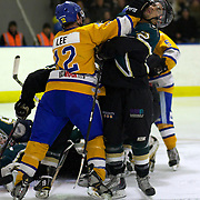 Southern Stampede player Braden Lee clashes with Heath Dunlop during the Southern Stampede V Dunedin Thunder National Ice Hockey League match at the Queenstown Ice Arena , South Island, New Zealand, 25th June 2011