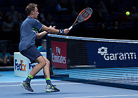 Tennis - 2017 Nitto ATP Finals at The O2 - Day One<br /> <br /> Mens Doubles: Group Eltingh/Haarhus: Henri Kontinen (Finland) & John Peers (Australia) Vs Ryan Harrison (United States) & Michael Venus (Australia)<br /> <br /> Henri Kontinen (Finland) with a smash close to the net <br /> <br /> COLORSPORT/DANIEL BEARHAM