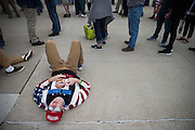 Nick Maldonato of Dunmore, Pa. lays on the ground outside Mohegan Sun Arena in Wilkes-Barre, Pa. while waiting to enter a Donald Trump rally on Monday, April 25, 2016.<br /> (Christopher Dolan / The Scranton Times-Tribune via AP)