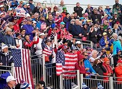 Auchterarder, Scotland, UK. 14 September 2019. Saturday morning Foresomes matches  at 2019 Solheim Cup on Centenary Course at Gleneagles. Pictured; Team USA fans cheering in grandstand beside the 1st tee. Iain Masterton/Alamy Live News