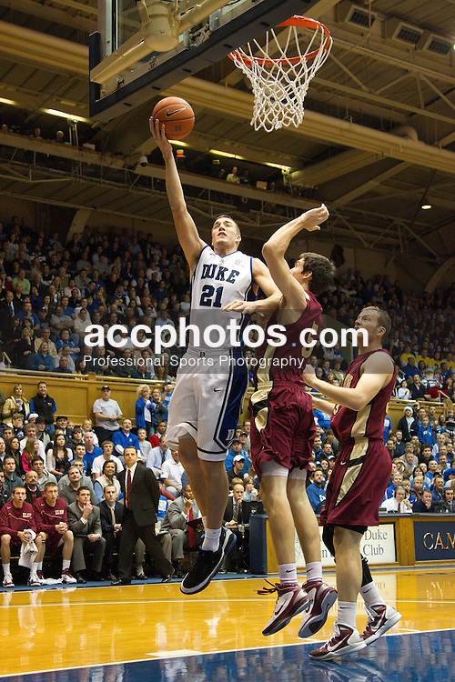 DURHAM, NC - DECEMBER 20: Miles Plumlee #21 of the Duke Blue Devils makes a basket while defended by Roger Dugas #5 of the Elon Phoenixon December 20, 2010 at Cameron Indoor Stadium in Durham, North Carolina. Duke won 98-72. (Photo by Peyton Williams/Getty Images) *** Local Caption *** Miles Plumlee;Roger Dugas