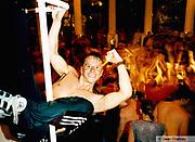 """Man""""pole"""" dancing in Es Paradis Club, San Antonio, Ibiza, 1999"""