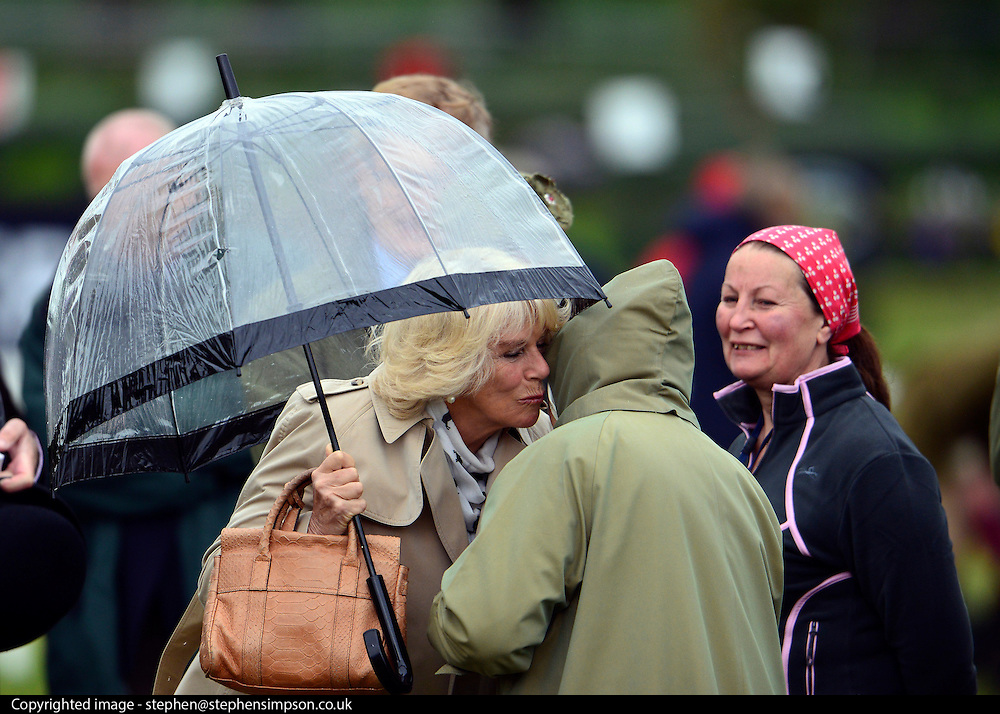 © Licensed to London News Pictures. 10/05/2013. Windsor, UK  Camilla, Duchess of Cornwall greets HRH Queen Elizabeth II as she watches horses in the show. The Royal Windsor Horse Show, set in the grounds of Windsor Castle. Established in 1943, this year will see the Show celebrate its 70th anniversary. Photo credit : Stephen Simpson/LNP