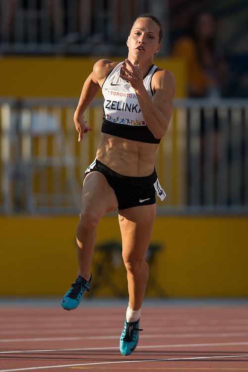 Jessica Zelinka of Canada competes in the 200 metre event of the women's heptathlon at the 2015 Pan American Games at CIBC Athletics Stadium in Toronto, Canada, July 24,  2015.  AFP PHOTO/GEOFF ROBINS