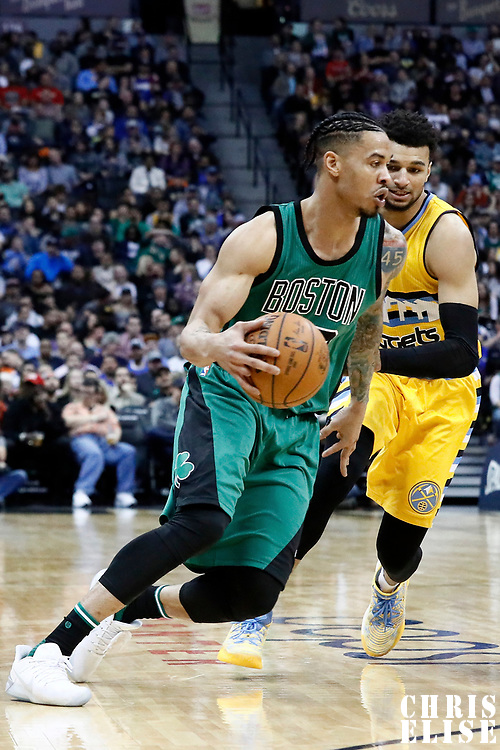 10 March 2017: Boston Celtics forward Gerald Green (30) drives past Denver Nuggets guard Jamal Murray (27) during the Denver Nuggets 119-99 victory over the Boston Celtics, at the Pepsi Center, Denver, Colorado, USA.
