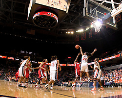 Virginia guard Monica Wright (22) blocks a shot by N.C. State guard Nikitta Gartrell (2).  The Virginia Cavaliers defeated the NC State Wolfpack women's basketball team 74-49 at the John Paul Jones Arena in Charlottesville, VA on February 1, 2008.