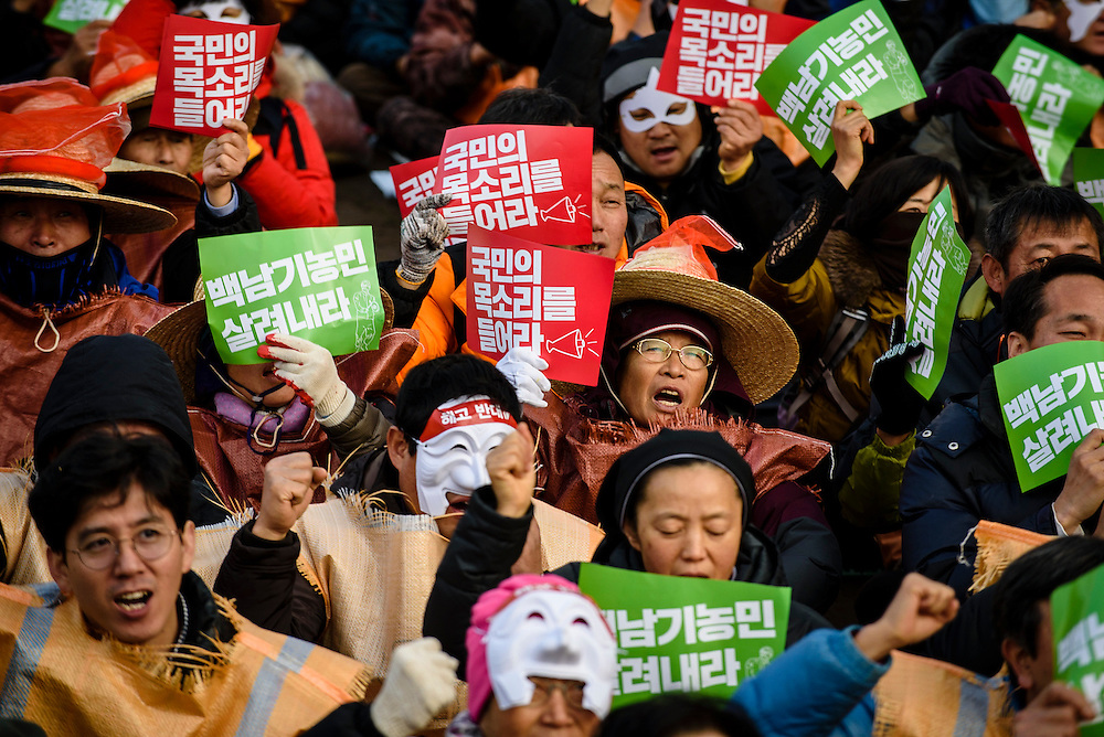 Protestors rally against against the conservative administration of President Park Geun-hye in Seoul, South Korea. Opponents have taken to the streets in recent weeks to oppose labor reforms that make it easier for companies to fire workers, and against government-issued public school textbooks that they say whitewash parts of Korean history, including the rule of President Park's father, Park Chung-hee, who ruled South Korea as president and dictator from 1961 to 1979. The police estimated 14,000 people attended Saturday's rally, though organizers put the numbers much higher. Similar protests last month resulted in clashes between protestors and the police, leading to multiple arrests and the severe injury of a farmer who was hit by a police water canon and remains unconscious in the hospital.