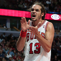 30 October 2010: Chicago Bulls Joakim Noah reacts after scoring against Detroit Pistons Ben Wallace during the Chicago Bulls 101-91 victory over the Detroit Pistons at the United Center, in Chicago, Illinois, USA.