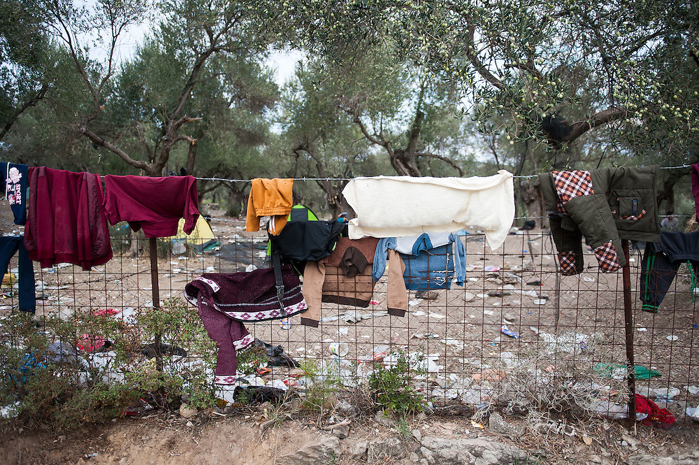 Clothes hanging to dry on a fence outside Moria camp, Lesvos, Greece.