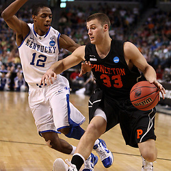 Mar 17, 2011; Tampa, FL, USA; Princeton Tigers guard Dan Mavraides (33) is guarded by Kentucky Wildcats guard Brandon Knight (12) during second half of the second round of the 2011 NCAA men's basketball tournament at the St. Pete Times Forum. Kentucky defeated Princeton 59-57.  Mandatory Credit: Derick E. Hingle