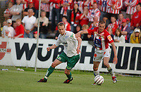 Fotball, Eliteserie, 25 juli 2004, Alfheim Stadion i Tromsø, TROMSØ IL - HAM KAM 0-3, HAM KAMs Geir Frigård og TILs Miika Koppinen<br /> FOTO: KAJA BAARDSEN/DIGITALSPORT