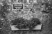 "Colleville sur Mer | Oct 15 2009..A flower box and a sign wich reads ""Tombe De Guerre Du Commonwealth - Commonwealth War Grave"" are seen on a stone wall of the cementery in the french village of Colleville sur Mer. Colleville sur Mer was one of the first villages to be freed by Allied Forces entering Europe on June 6, 1944 (D-Day).  ..Photo: juelich/ip-photo.com"