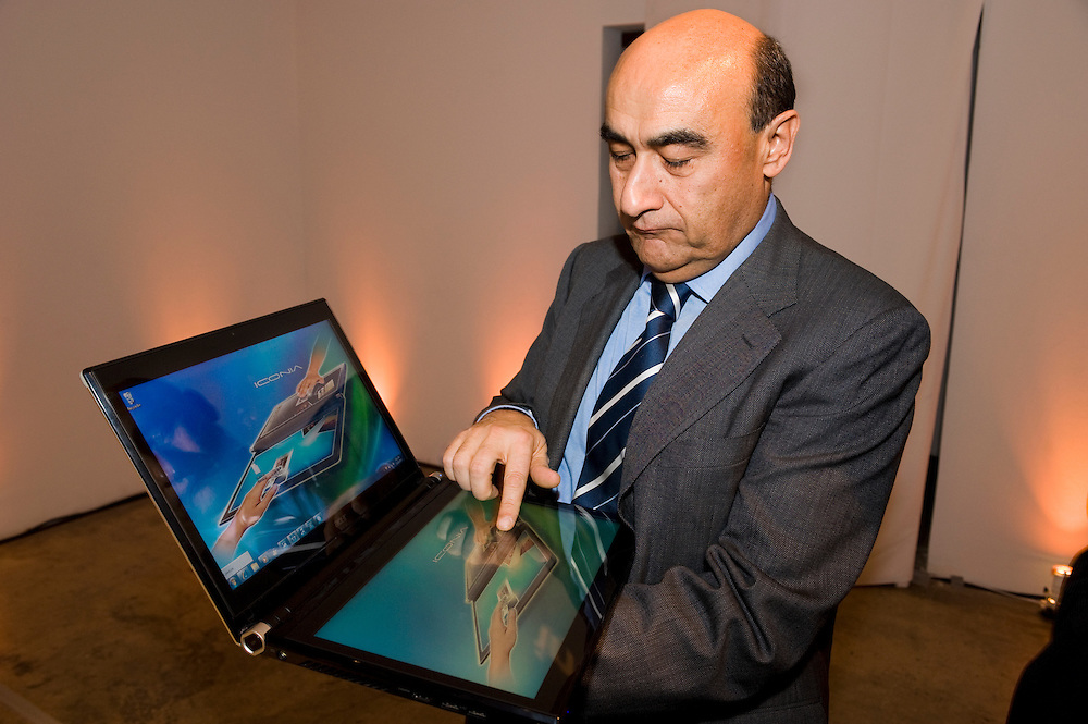 Gianfranco Lanci CEO of Acer Inc. with a dual-screen laptop..Gianfranco Lanci, CEO of Acer Inc, the world's No. 2 PC vendor, announces new dual-screen laptop in New York on November 23/2010