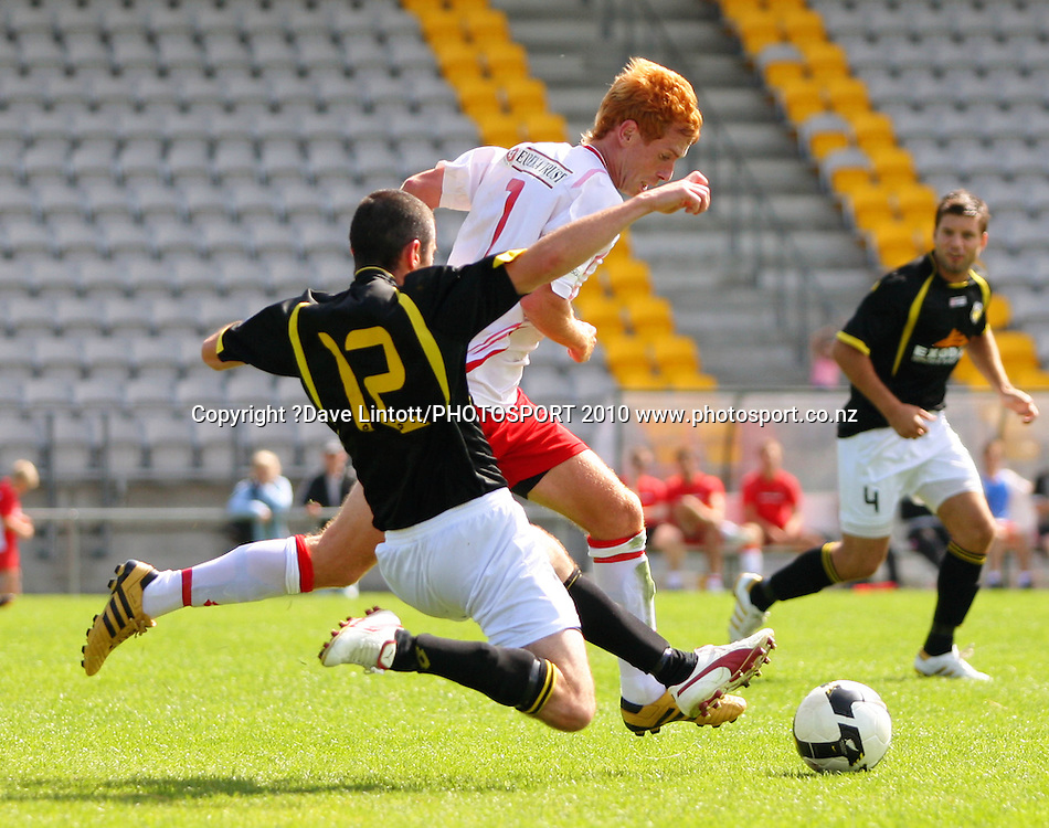 Canterbury's Aaron Clapham tries to get past Bryan Little.<br /> NZFC soccer  - Team Wellington v Canterbury United at Porirua Park, Wellington. Sunday, 14 March 2010. Photo: Dave Lintott/PHOTOSPORT
