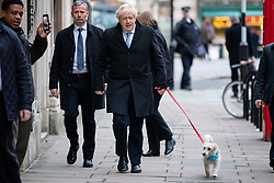 © Licensed to London News Pictures. 12/12/2019. London, UK. Prime Minister Boris Johnson with Dilyn the dog at Methodist Central Hall to cast his vote in the 2019 General Election. Photo credit: Rob Pinney/LNP