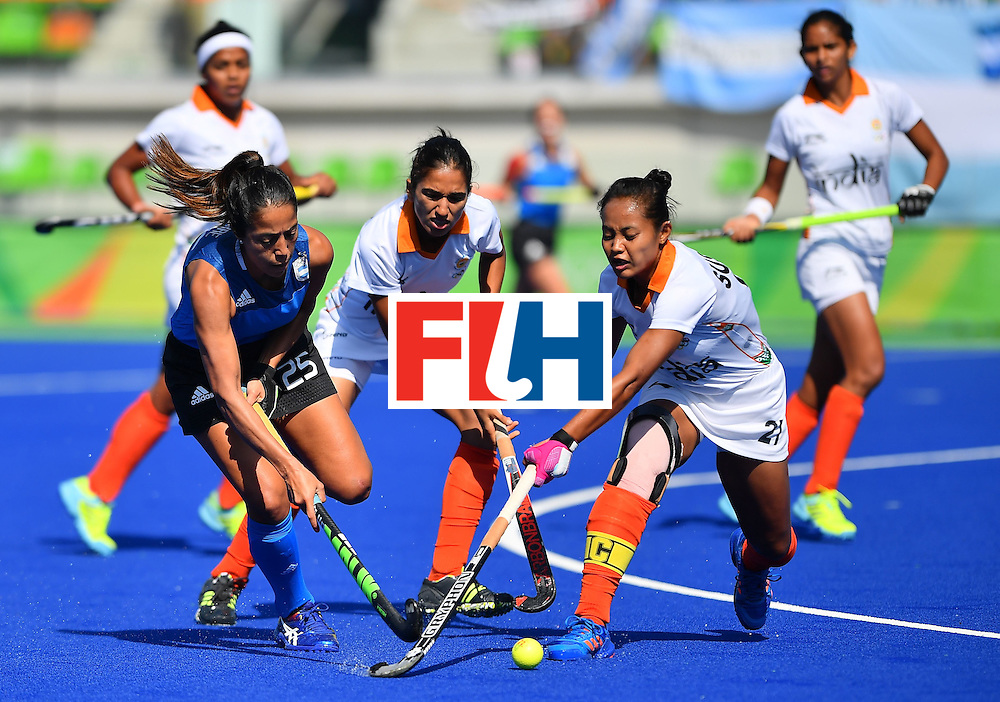 Argentina's Gabriela Aguirre (L) and India's Sushila Pukhrambam vie during the women's field hockey Argentina vs India match of the Rio 2016 Olympics Games at the Olympic Hockey Centre in Rio de Janeiro on August, 13 2016. / AFP / Carl DE SOUZA        (Photo credit should read CARL DE SOUZA/AFP/Getty Images)