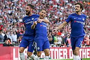 Chelsea Midfielder Eden Hazard celebrates his penalty goal 1-0 with Chelsea Oliver Giroud and Chelsea Defender Marcos Alonso during the FA Cup Final between Chelsea and Manchester United at Wembley Stadium, London, England on 19 May 2018. Picture by Phil Duncan.