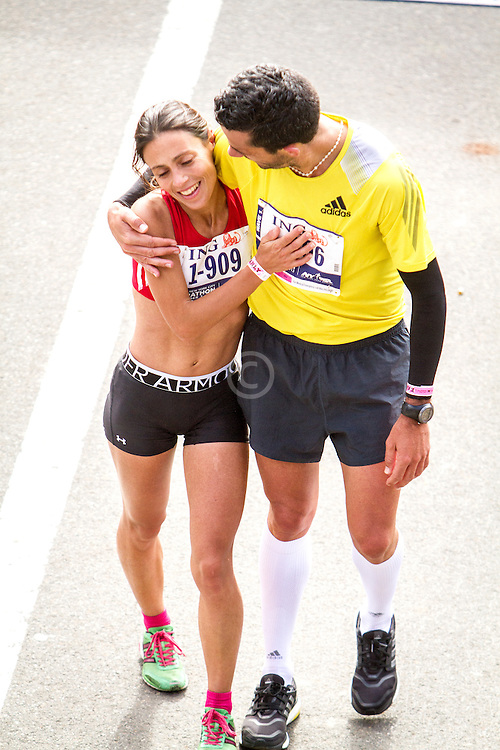 ING New York CIty Marathon: Vera Nunes and Rui Muga of Portugal finish race together
