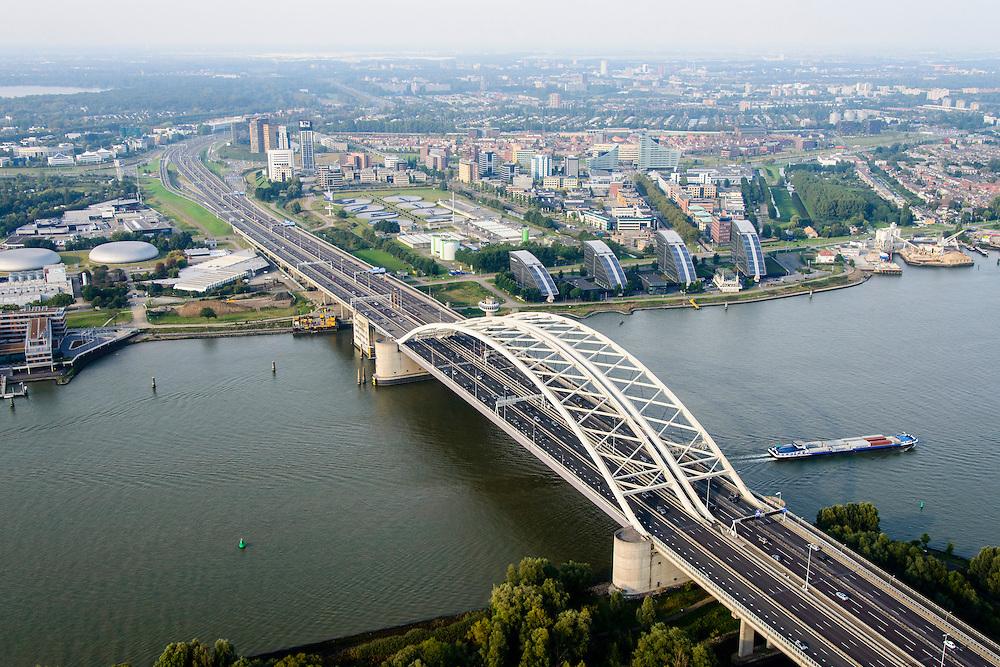Nederland, Zuid-Holland, Gemeente Rotterdam, 28-09-2014; Van Brienenoordbrug met autosnelweg A16 over de Nieuwe Maas. Rivium en Kralingse Veer (deelgemeente Prins Alexander) in de achtergrond<br /> River Meuse with the double bridge (Van Brienenoord) of the motorway A16, skyline Rotterdam<br /> luchtfoto (toeslag op standard tarieven);<br /> aerial photo (additional fee required);<br /> copyright foto/photo Siebe Swart