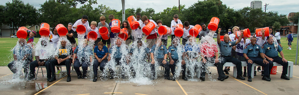 Houston ISD police staff take the ALS Ice Bucket Challenge with the help of students at Lanier Middle School, August 29, 2014.