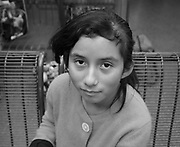 Tucson, Arizona, USA, June 26, 2014: An 11-year-old Guatemalan girl waits with her mother in Tucson at bus station where she was dropped off by the U.S. Border Patrol after being apprehended near Douglas, Arizona, USA, where they crossed the border illegally from Mexico.  The two traveled for about five days from Guatemala to get to the Arizona border.  They, along with others, heard in Guatamala that mothers with children could find work in the U.S.  Recently flooded with undocumented migrants from Central America, federal authorities are transporting children with adults to bus stations where they will head to other states in the U.S.  Their status in the U.S. will be addressed by authorities after they reach their destination.