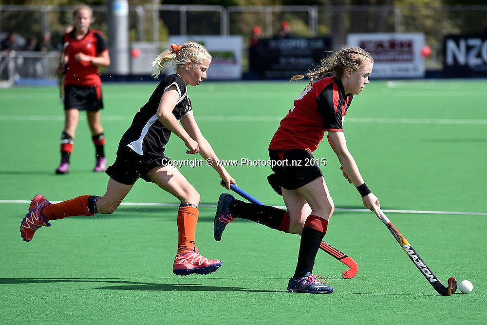 Isabella House (R of Canterbury dribbles the ball with Hannah Findlay of Hawkes Bay during the Canterbury vs Hawkes Bay Collier Trophy U13 Girls Hockey Final at the Manawatu Hockey Stadium in Palmerston North on Saturday the 10 October 2015. Copyright photo by Marty Melville / www.Photosport.nz