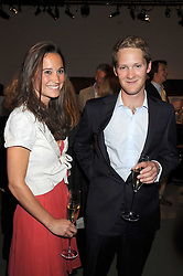 EARL (George) PERCY heir to the 12th Duke of Northumberland and PIPPA MIDDLETON at the annual Sotheby's Summer Party held at their auction rooms 34-35 New Bond Street, London W1 on 19th June 2008.<br />