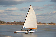 Iceboat on Niles Pond, near the tip of Eastern Point in Gloucester, MA. Iceboats can achieve speeds of 50 mph, saling faster than the actual wind velocity.