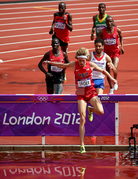 Evan Jager of the USA leads the pack during a heat for the men's 3000m Steeplechase during track and field at the Olympic Stadium during day 6 of the London Olympic Games in London, England, United Kingdom on August 3, 2012..(Jed Jacobsohn/for The New York Times)..