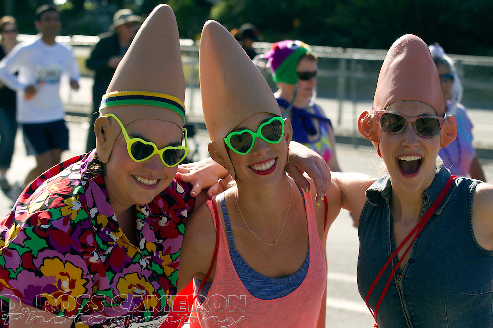 """""""Coneheads"""" Amy Kuhn of Denver, from left, Rochelle Raykoff of San Francisco and Elly Hanshaw of San Diego get their heads together during the 102nd running of the Bay to Breakers 12K in San Francisco, Sunday, May 19, 2013. More than 30,000 runners -- from the elite to the weekend warrior -- made the 7.62-mile trek from Howard and Spear to the Great Highway. (Photo by D. Ross Cameron)"""