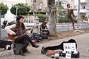 Israel, Tel Aviv, Rothschild Boulevard. A street musician and juggler April 2009