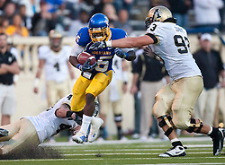 October 10, 2009; San Jose, CA, USA;  San Jose State Spartans running back Brandon Rutley (15) is tackled by Idaho Vandals defensive tackle Michael Cosgrove (93) and linebacker Paul Senescall (42) during the second quarter at Spartan Stadium.
