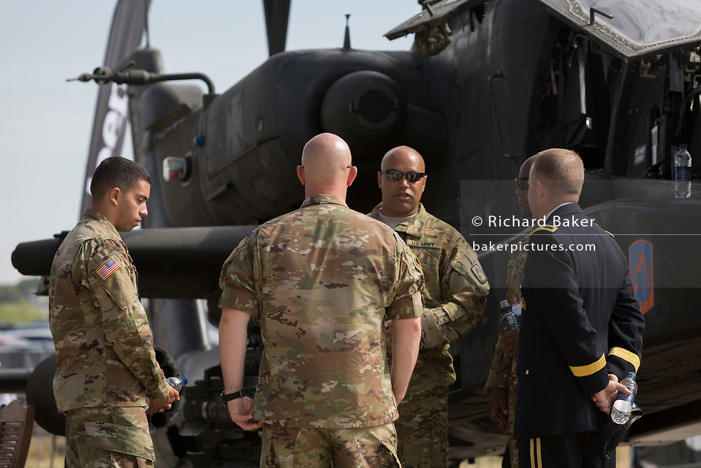 US Army personnel of an Apache helicopter at the Farnborough Airshow, on 16th July 2018, in Farnborough, England.