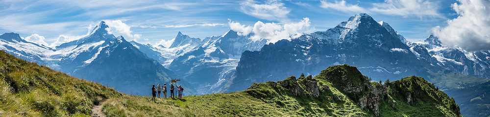 The Schreckhorn, Finsteraarhorn and Eiger (left to right) rise impressively above Grindelwald, in Switzerland, the Alps, Europe. The Finsteraarhorn (at left 4274 m / 14,022 ft) is the highest mountain in the Bernese Alps and the most prominent peak of Switzerland (in terms of height above the lowest topographic contour at the mountain's base). The Schreckhorn (4078 m / 13,379 ft) is the northernmost summit rising above 4000 meters in Europe. On the right, the north face of the Eiger rises to 3970 m (13,020 ft). This whole massif and surrounding glaciers were designated as part of UNESCO's Jungfrau-Aletsch World Heritage Site. This image was stitched from multiple overlapping photos.