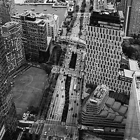Back in 2013 while on assignment photographing the first fully outfitted floor of One World Trade Center I snapped a few images of the city. While the view out over the city was stunning I was much more interested in all of the activity happening just around the &quot;neighborhood.&quot; Being able to look down from such a height revealed a world of patterns, shapes, and people scurrying about. It was fascinating.  <br /> It was a dreary overcast day as well and while that may not offer the everyday pedestrian much with regards to experience, photographers love it! It works to considerably benefit the black and white photographer as it gives us large, soft shadows, and a flat negative or file to work with. Black and white images made on an overcast day tend to sound like a somber piece by Mendelssohn. There is a richness and romantic quality which the clouds bestow upon the world.