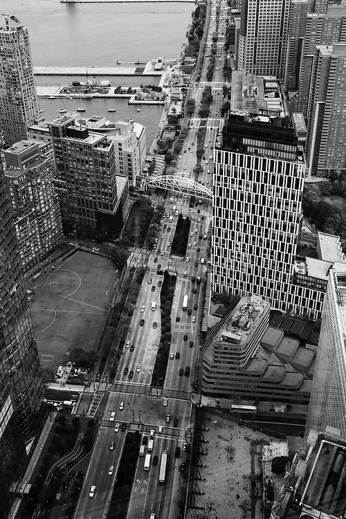 Back in 2013 while on assignment photographing the first fully outfitted floor of One World Trade Center I snapped a few images of the city. While the view out over the city was stunning I was much more interested in all of the activity happening just around the &quot;neighborhood.&quot; Being able to look down from such a height revealed a world of patterns, shapes, and people scurrying about. It was fascinating.  <br />
