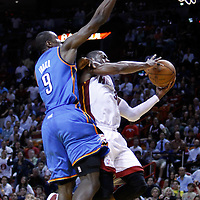 16 March 2011: Miami Heat shooting guard Dwyane Wade (3) goes for the layup against Oklahoma City Thunder power forward Serge Ibaka (9) during the Oklahoma City Thunder 96-85 victory over the Miami Heat at the AmericanAirlines Arena, Miami, Florida, USA.