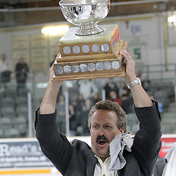 TRENTON, ON - Apr 22, 2016 -  Ontario Junior Hockey League game action between Trenton Golden Hawks and the Georgetown Raiders. Game 5 of the Buckland Cup Championship Series  at the Duncan Memorial Gardens in Trenton, Ontario. Trenton Golden Hawks Staff Member hoists the Buckland Cup.<br /> (Photo by Tim Bates / OJHL Images)