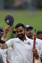 August 14, 2017 - Colombo, Sri Lanka - Indian captain Virat Kohli walks back to pavilion after winning the Test series 3-0 after the 3rd Day's play in the 3rd and final Test match between Sri Lanka and India at the Pallekele international cricket stadium at Kandy, Sri Lanka on MOnday 14 August 2017. (Credit Image: © Tharaka Basnayaka/NurPhoto via ZUMA Press)