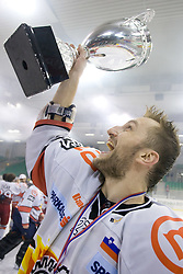 Miha Rebolj of Acroni Jesenice celebrates with a Trophy at 6th Round of ice-hockey Slovenian National Championships match between HDD Tilia Olimpija and HK Acroni Jesenice, on April 2, 2010, Hala Tivoli, Ljubljana, Slovenia.  Acroni Jesenice won 3:2 after overtime and became Slovenian National Champion 2010. (Photo by Vid Ponikvar / Sportida)
