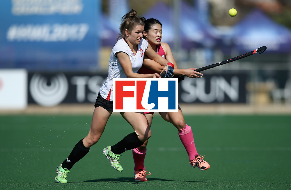 JOHANNESBURG, SOUTH AFRICA - JULY 14: Amelia Katerla of Poland and Emi Nishikori of Japan battle for possession during day 4 of the FIH Hockey World League Semi Finals Pool B match between Poland and Japan at Wits University on July 14, 2017 in Johannesburg, South Africa. (Photo by Jan Kruger/Getty Images for FIH)