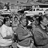 Families line up at a food distribution site in San Joaquin in Fresno County in California's Central Valley, CA, Wednesday, Oct. 5, 2016. One of the worst droughts in California history officially ended this spring in all of the state's counties except Fresno, Kings, Tulare and Tuolumne. <br />